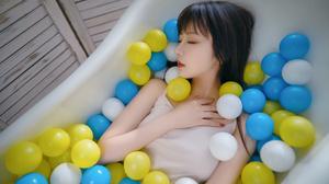 Asian In Bathtub Ball Pit 4032x2690 Wallpaper