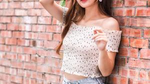 Asian Model Women Long Hair Dark Hair Depth Of Field Bricks Wall White Tops Earring Leaning Flowers  2560x3840 Wallpaper