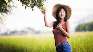 Asian Model Women Long Hair Brunette Straw Hat Shirt Jeans Field Trees Branch Leaves Depth Of Field  3840x2559 Wallpaper