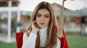 Women Face Portrait Coast Depth Of Field Orange Jacket White Sweater Looking At Viewer Touching Face 2048x1152 Wallpaper
