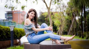 Asian Model Women Long Hair Dark Hair Sitting Depth Of Field Trees Bushes Barefoot Sandal Heels Jean 4562x3041 Wallpaper