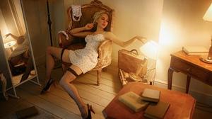 Women Blonde Dress High Heels Warm Light Mirror Books Suitcase Model Wooden Floor Sitting Chair Wome 2024x1265 Wallpaper