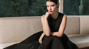 Anya Taylor Joy Women Actress Lipstick Dark Hair Sitting Indoors Black Dress 928x1392 Wallpaper