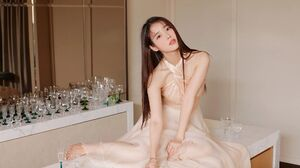 IU Iu Lee Ji Eun Women Orange Dress Brunette Korean Barefoot Long Hair Glasses 1943x1295 Wallpaper