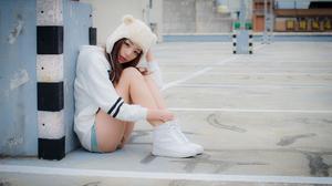 Asian Women Model Brunette Sitting Sneakers Parking Lot Women Outdoors 2048x1367 Wallpaper