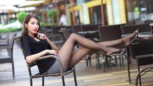 Asian Model Sitting High Heels Short Skirt Nylon Stockings Depth Of Field Long Hair Dark Hair Blouse 1920x1280 Wallpaper
