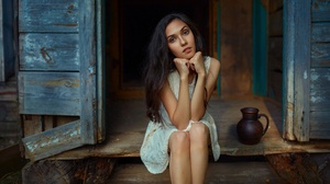 Andrey Metelkov Model Women Brunette Brown Eyes Dress Bare Shoulders Legs Sitting Touching Face Long 2048x1152 wallpaper