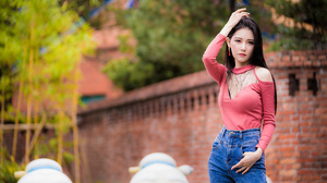 Asian Model Women Depth Of Field Long Hair Dark Hair Jeans Red Shirt Trees Wall Bricks Earrings 3840x2559 Wallpaper
