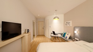 Room Hotel Cushion Bed Television Laptop Table 5616x3652 Wallpaper