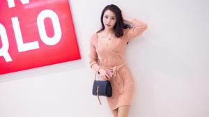 Asian Women Model Brunette Long Hair Orange Dress Handbags Hands In Hair Looking At Viewer 1920x1080 Wallpaper