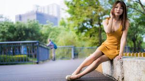 Asian Model Women Long Hair Dark Hair Sitting Yellow Dress Trees Depth Of Field Bushes Fence White H 4562x3041 Wallpaper