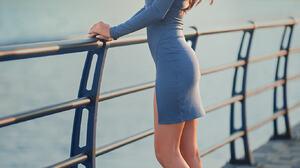 Dmitry Shulgin Women Brunette Long Hair Wavy Hair Dress Blue Clothing Shoes High Heels Fence Water O 1365x2048 Wallpaper