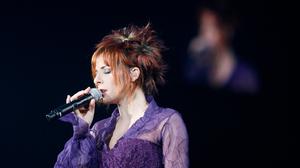 Mylene Farmer French Singer Redhead Microphone Violet Dress Closed Eyes Black Background Singing 2912x4368 wallpaper