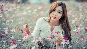Model Depth Of Field Flower Brunette Long Hair Brown Eyes 4500x3001 Wallpaper