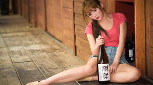 Asian Model Women Long Hair Brunette Red Shirt Jeans Shorts Bottles Sneakers Sitting Wood Flooring 1920x1281 Wallpaper