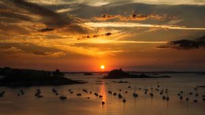 Earth Boat Ocean Sea Rock Sun 2560x1440 wallpaper